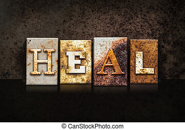Heal Letterpress Concept on Dark Background - The word HEAL...