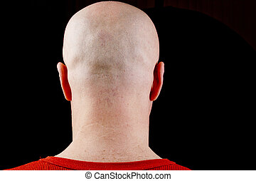 Bald head middle-aged man on a black background.