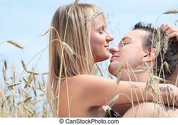 A beautiful couple in wheat field - A beautiful couple...