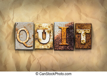 Quit Concept Rusted Metal Type - The word QUIT written in...