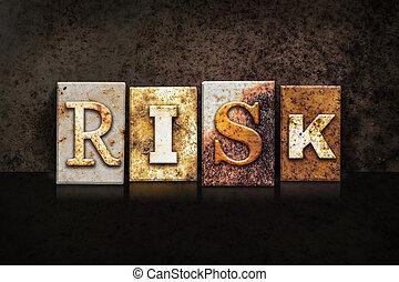 Risk Letterpress Concept on Dark Background - The word...