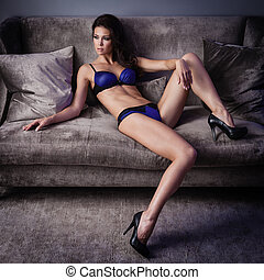 Sexy lingerie - Beautiful lady in sexy lingerie lies on a...