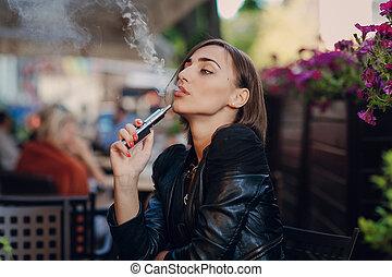beautiful glamorous brunette smoke electronic cigarette -...
