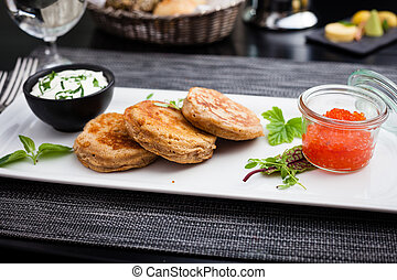 Pancakes with caviar - Pancakes with red caviar and sour...