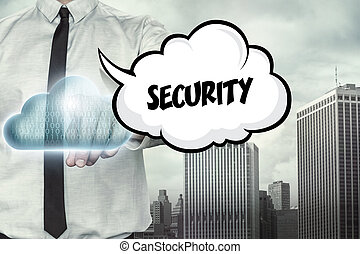 Security text on cloud computing theme with businessman on...
