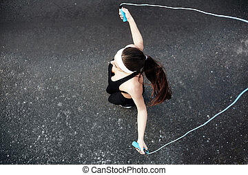 Sporty girl exercising - Girl in activewear exercising with...