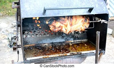 Pork meat grilling - Grilling of the pork leg on the rotary...