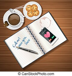 booklet and mobile phone with chocolate cup and cookies -...