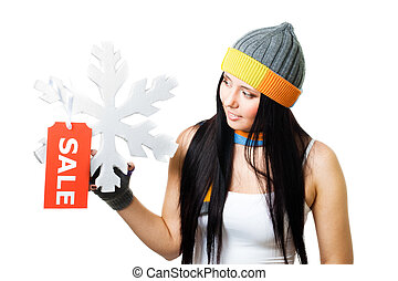 Woman hold snowflake with sale tag isolated on white