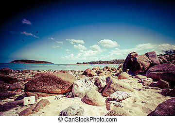 beautiful tropical rocky beach with rocks on the island of...