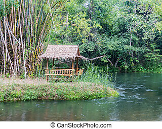 bamboo hut near the river in the tropical forest