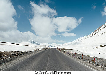 The road between beautiful snow mountains - The road between...
