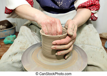 Modeling clay. Handmade pot from clay. The whistle of clay hands