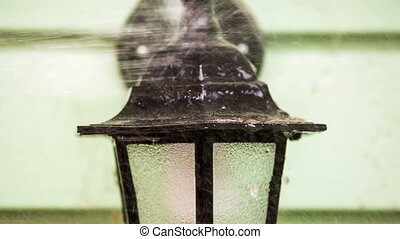 Person Cleaning Street Lamp - CLOSE UP: In the frame there...