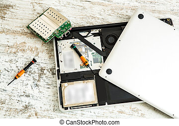 Laptop repair - A open laptop getting repaired