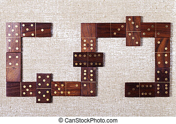 abstract wooden dominoes on a light background - a abstract...