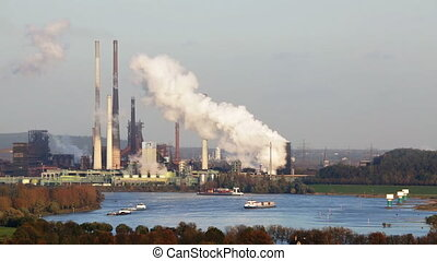 Coking Plant And River - A large steaming coking plant in...