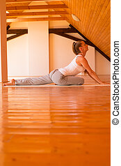 Woman practicing Yoga in a Studio - A young Woman practicing...