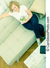 Young woman on the sofa