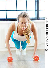 Girl in the gym - Sport. Beautiful woman in the gym