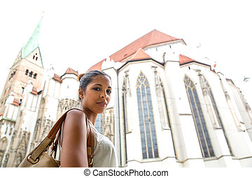 Young woman at the cathedral - Hispanic girl in front of the...
