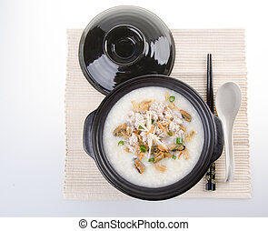 Traditional chinese pork porridge rice gruel served in...