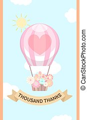 Balloon with flower basket and brown ribbon in the sunny sky...