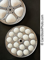 Fresh steamed Indian idly in trays - Fresh Indian Idly Idli...