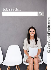 Job search Confident young businesswoman holding paper while...