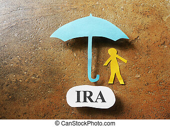 IRA savings - Paper cutout figure with an umbrella and IRA...