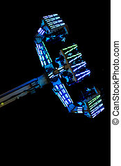 Carnival Ride Night - Carnival ride at night with glowing...