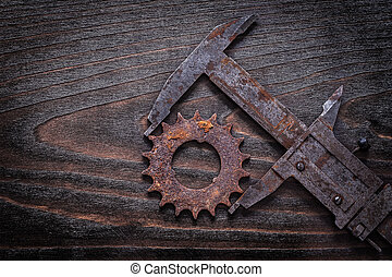 Rusty retro-styled measuring calipers with pinion gear on...