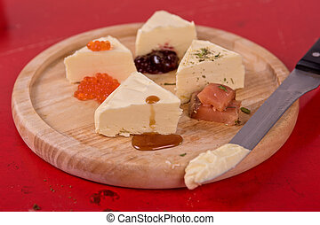 fresh butter set with different products as caviar jam...