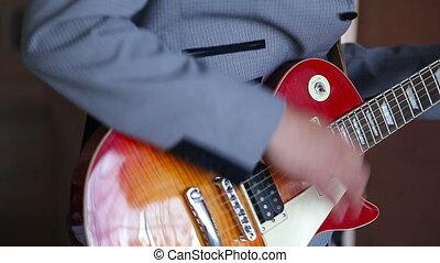 man playing guitar - guy playing electric guitar les paul