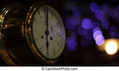 clock on the wall shows 6 with bokeh effect