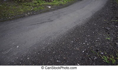 Driving Danger Dirt Road Mudslide - Tilt up shot of a dirt...