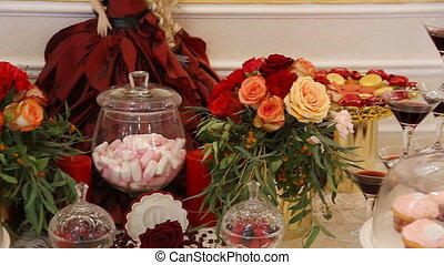 Homemade fancy set table with sweets candies, cake,...