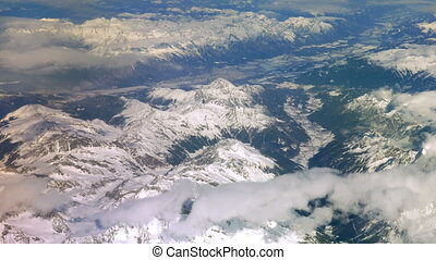 View of the Mountains from the Plane - Snow-capped mountains...