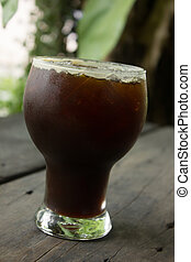 Iced Americano. - Delicious ice coffee americano on wood...