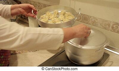 Woman cooks manti