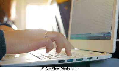 Female Fingers Typing on the Keyboard