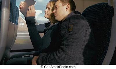 Happy Couple Taking Selfie on Train