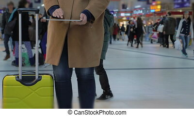 Woman Using Tablet PC While Waiting for Departure - Woman...