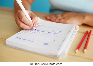 Woman sketching web design in office, close up