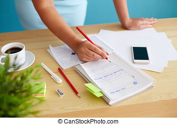 Woman sketching web design in office