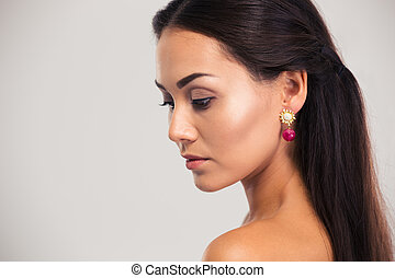 Beauty portrait of a charming woman looking away isolated on...