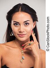 Closeup portrait of a pretty female model - Jewelry concept....