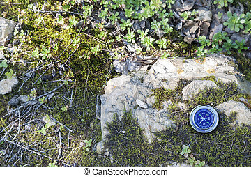 Analogic Compass Abandoned on the stone in the summer