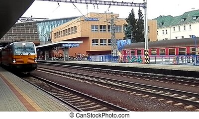 The train leaves the station Poprad - Trainset carrier...