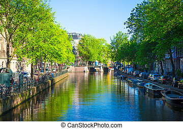 Beautiful canal in the old city of Amsterdam, Netherlands,...